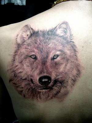 Wolf tattoo on the back