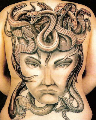 totem carver, heavily tattooed man, world traveler, circus performer, A full back tattoo design is always impressive because of its size,