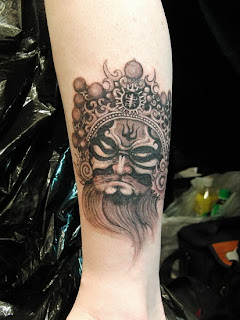 beijing opera face tattoo design on the leg