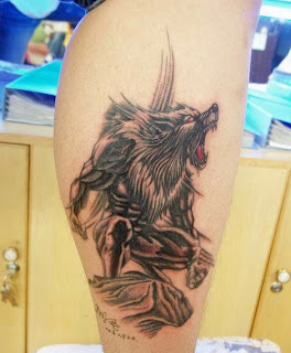 werewolf tattoo design on the leg