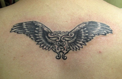 heart-wing tattoo on the back