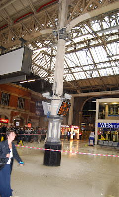 Rain pouring through the roof at Victoria Station, London