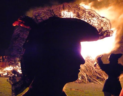 Silhouette of girl in hat at Southover Bonfire firesite in November 2009