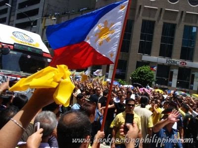 Cory's yellow ribbons in front of the Philippine national flag