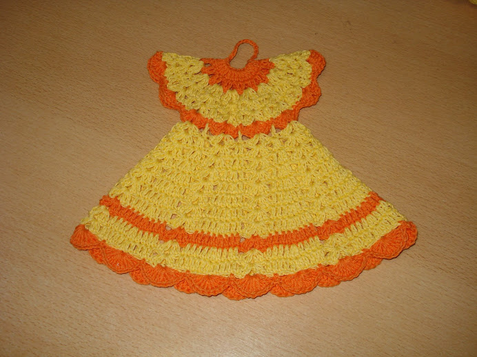 agarradera vestido en naranja y amarillo $6
