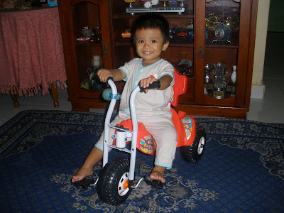 afi with his cycle yg dibeli arwah atok