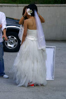 Second picture of the bride showing that her glowing orange shoes are visible even when she is not holding her dress up
