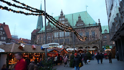 Image of the Rathaus (Town Hall) of Bremen (Germany) behind part of the Weihnachtsmarkt (Traditional Christmas Market).