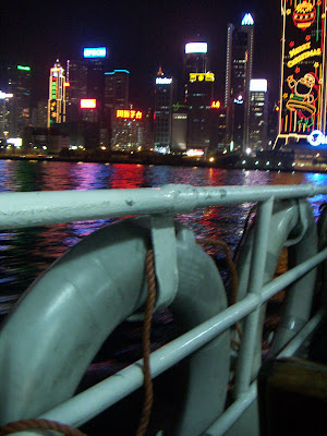 Image of Hong Kong buildings at night over Christmas from beside the Star Ferry pier on the Tsim Sha Tsui, Kowloon. Photo taken by Ann Light, used with the permission of the photographer.