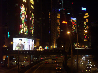 Image of buildings in Hong Kong lit up for Christmas, at night. Photo taken by Ann Light, used with the permission of the photographer.
