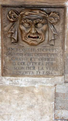 Image of a nasty person, carved in marble in bas-relief, whose mouth was a slot to put denunciatory letters in, in Venice.