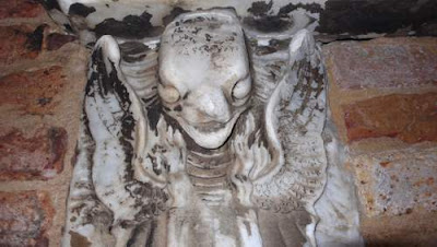 Carven image of a demon found on the islet Cemetario in the Venetian lagoon.