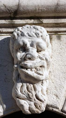 Image of a grotesque carved in marble in Venice.