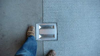 Image of piece of sturdy stainless steel set in the ground.