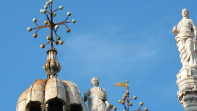 Image of the spires and peculiar crosses of St. Mark's Basilica in Saint Mark's Square, Venice.