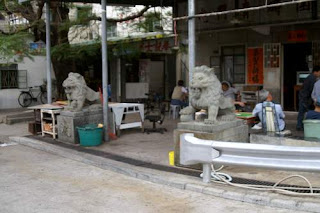 Image of guardian lions outside a restaurant in Tuen Mun, Hong Kong.