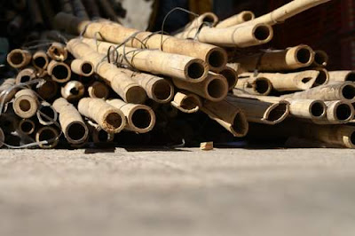 A pile of cut bamboo lying on the sidewalk in Hong Kong.