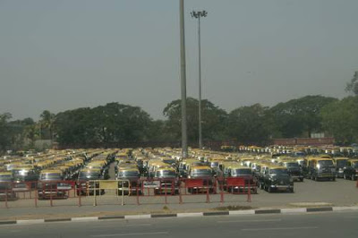 Image of a fleet of Ambassador (car) taxis at Mumbai International airport, waiting to whisk the middle class away to work.