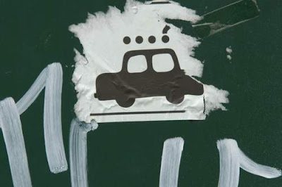 Graffiti image of a sticker of a car from the Old Town centre of Genoa, Italy.