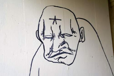 Graffiti image of a street-wise anarchist/thug in Geneva, Switzerland