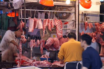 Image of a Hong Kong butcher's shop at a wet market.
