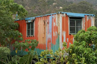 Image of a container shack/hunting blind (in Tuen Mun). A fixer-upper in need of some TLC, but perfect, already, for back-to-nature unabomber types...