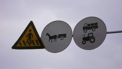 Image of three road signs in China.
