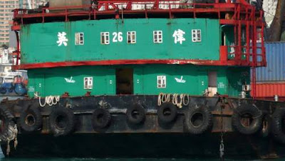 Image of the living quarters for the crew on a barge in a Hong Kong harbour.