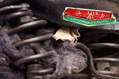 Close-up image of a bicycle seat, in China, seat manufactured by Suong Zong Dalian Zuo Chang.