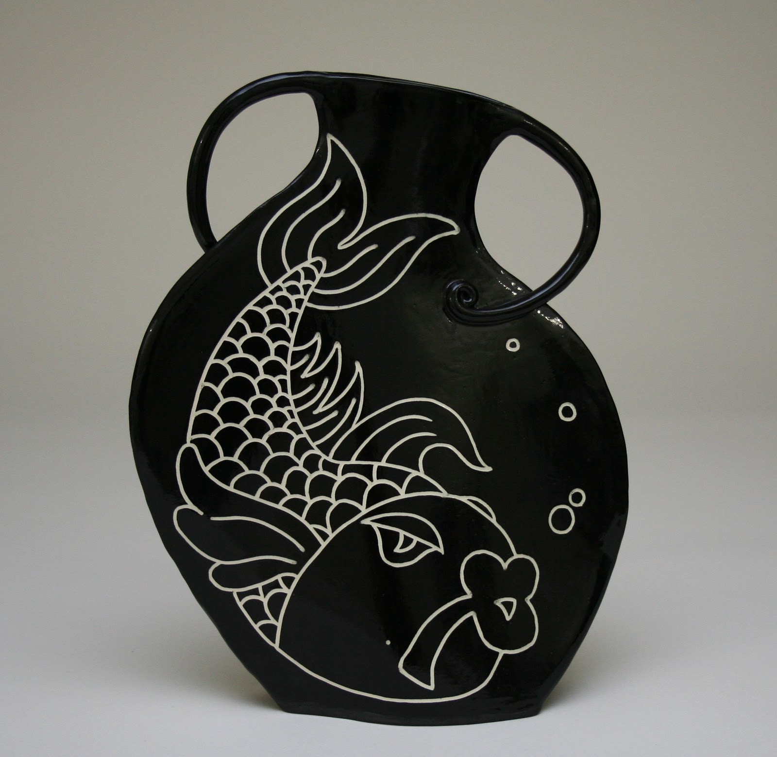 Jane cartwright pottery sgraffito dancing vase this flattish slab built vase is about 13 tall with carved fish on both sides its great fun to make and i love that it looks like its dancing reviewsmspy