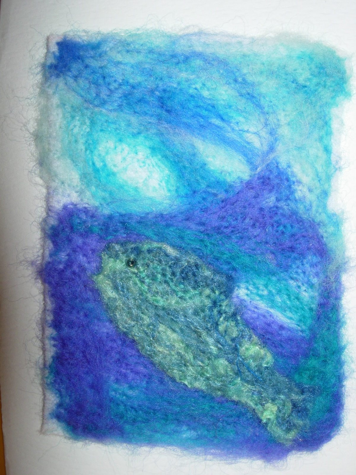 fish rising to the surface, felted on embellisher machine