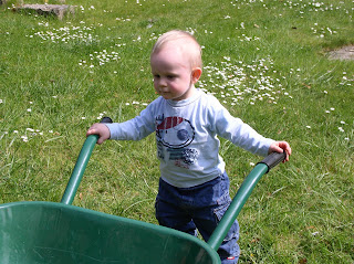 Benjamin helping in the yard