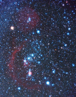 Orion constellation: Orion's belt in the middle (3 stars), bright-yellow Betelgeuse at top left, bright-blue Rigel at bottom right.