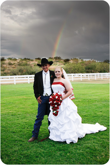 Bride and Groom with Rainbow in the background