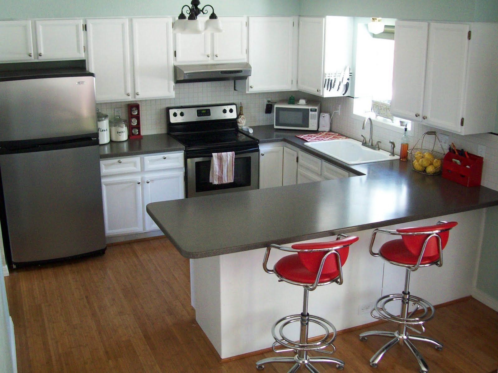 Remodelaholic how to paint your kitchen cabinets for Painted cabinets in kitchen