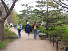 Grandma and girls walking at the gardens