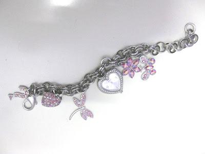 ankle charm bracelet tattoo designs. I want my Charm Bracelet Watch from