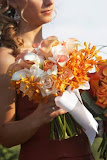 Pink roses, calla lillies with orange floral flower hand tied bouquet