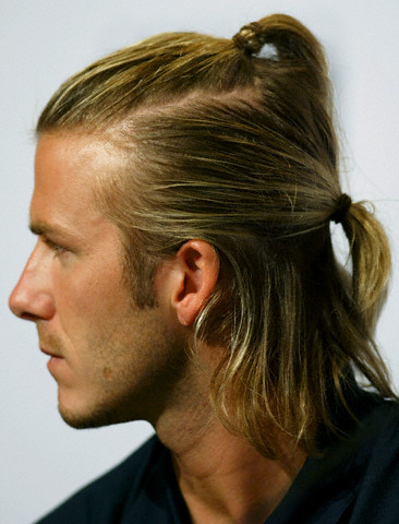 2002 men long hairstyle. Brunette hair was cut into mid length graduated