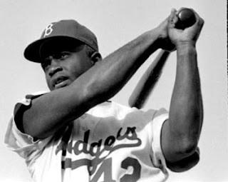 Jackie Robinson holding a kli/baseball bat