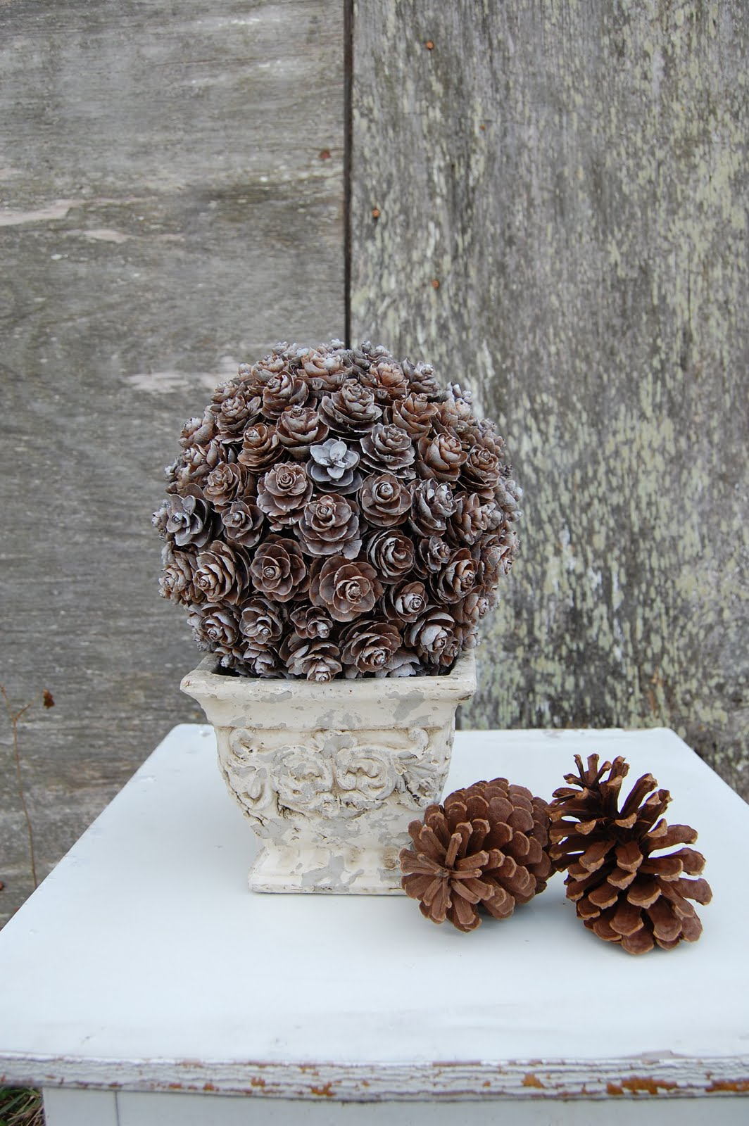 Pine cone topiary somewhat simple for Christmas decorations using pine cones