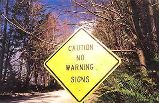 Caution No Warning Signs sign