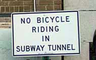 No Bicycle Riding in Subway Tunnel sign
