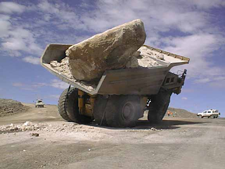 rock overloads dump truck