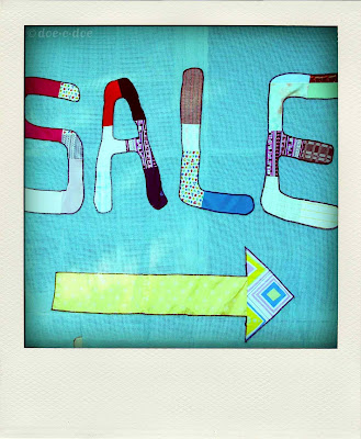 a good, old-fashioned church rummage sale with a handmade patchwork sign