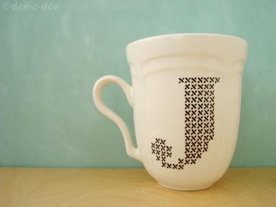 cross stitch design letter decoration on mug