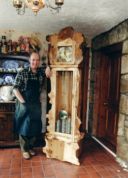 Hand carved Woodland style long case clock.