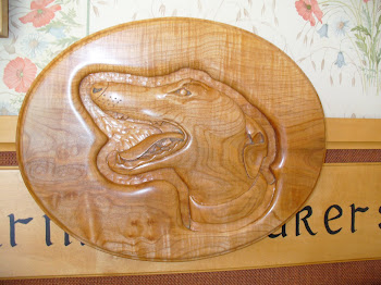 Greyhound head study, hand carved in ripple sycamore.