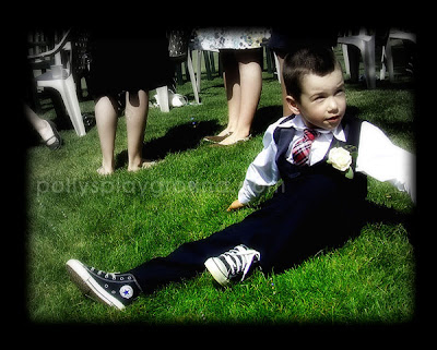 ring bearer sitting in grass