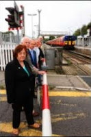 pic of people by level crossing